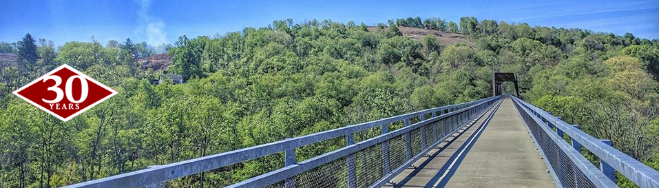 With a span of nearly 1,000 feet, the McDonald viaduct is the Montour Trail's longest bridge, crossing over local roads, a stream and another rail-trail. Its vantage offers expansive views of the landscape and, almost 100 feet below, the connecting Panhandle Trail that leads to West Virginia.